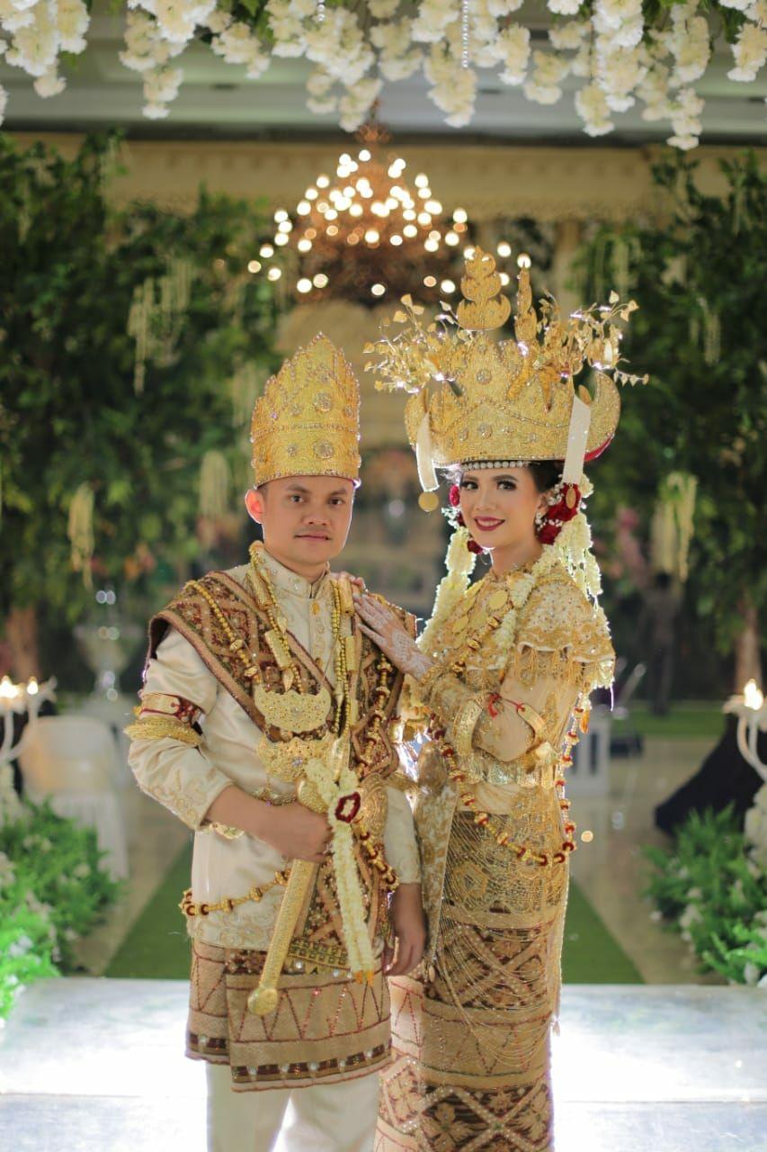 pakaian tradisional pria lampung
